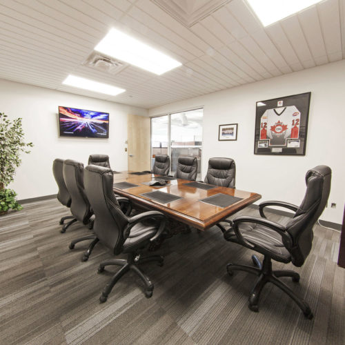 Board room with hardwood table and chairs