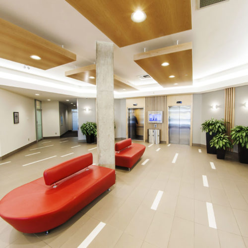 Large waiting area couches and elevators